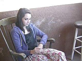 Teen pornstar and smoking girl Emily Grey enjoys a cigarette break during a porn shooting filmed with spy cam